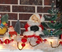 Paper pulp Santa in sleigh and chalkware Santa on mantel